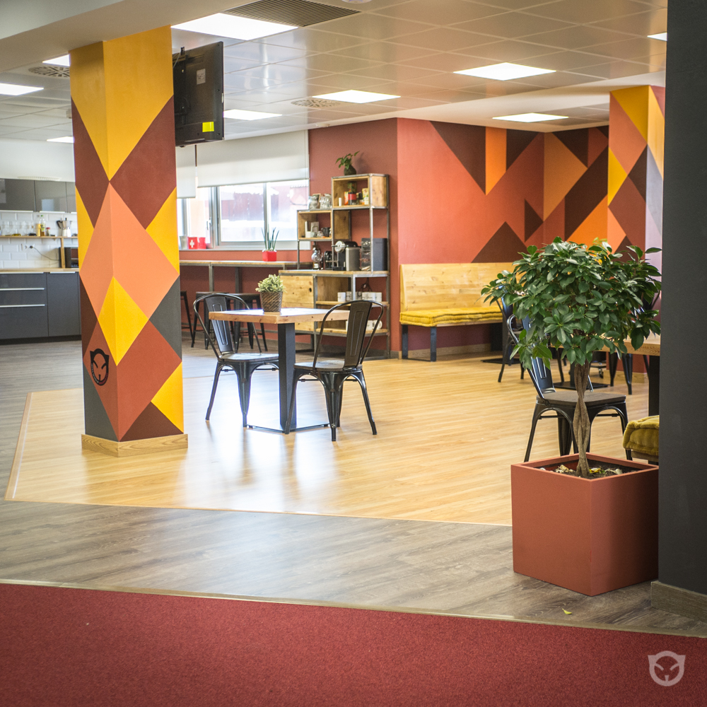 TravelPerk office design, renovation and original wall painting in Barcelona